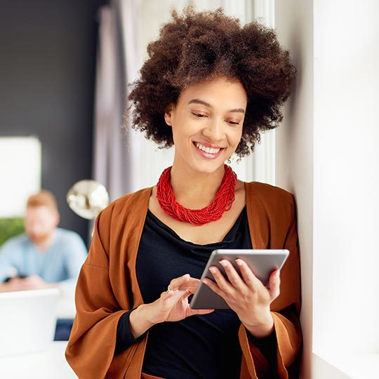 what is seo photo of a lady smiling while searching something on her tablet
