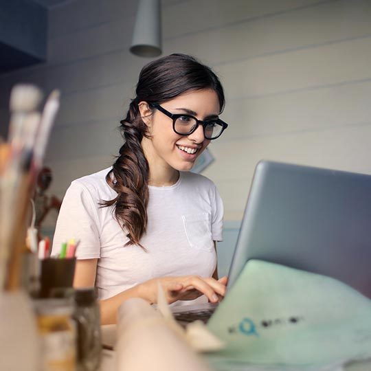 get your business online photo of a woman setting up her online presence on her laptop